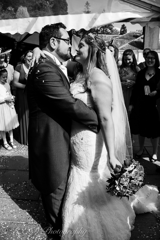 black and white wedding photography bride and groom confetti