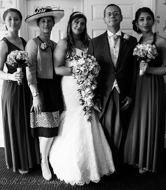 black and white wedding photography bride with family