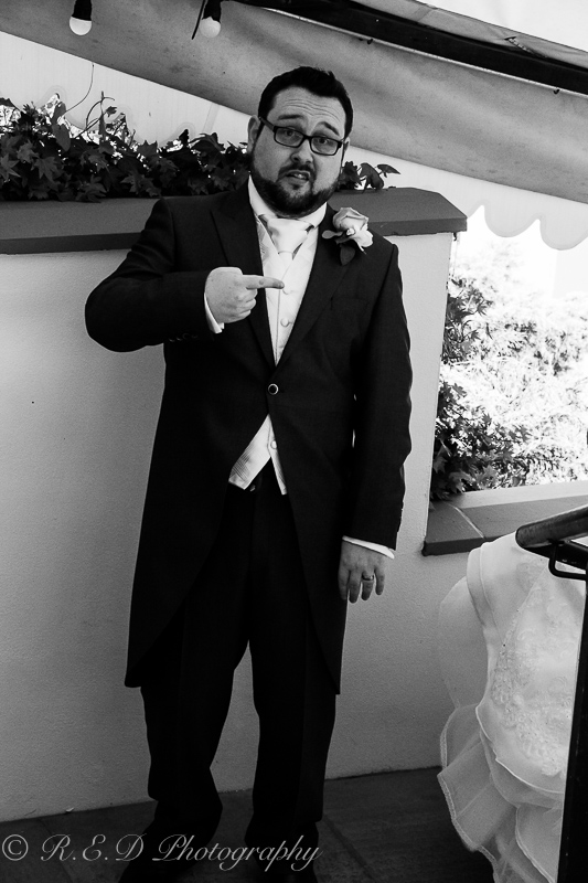 black and white wedding photography the groom
