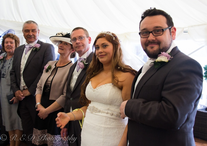 wedding photography bride and groom with family