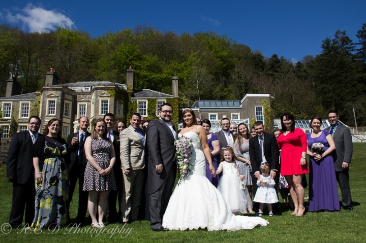 wedding photography bride and groom with guests