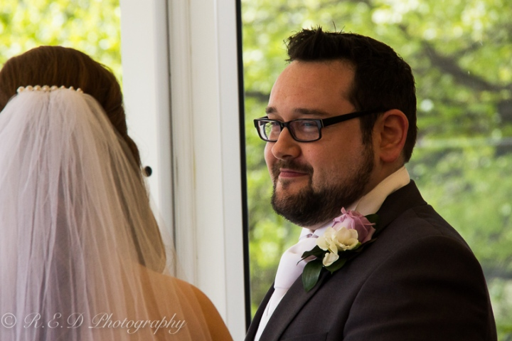 wedding photography groom during vows