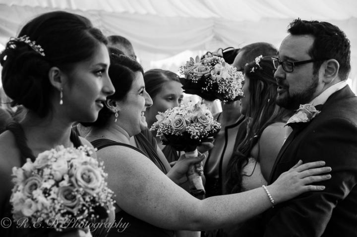 wedding photography groom welcoming guests