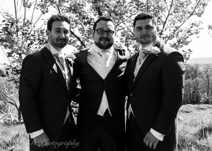 black and white wedding photography groom with family