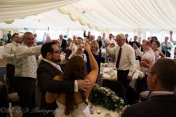 wedding photography toasting the couple